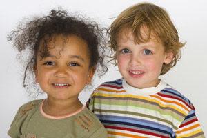 mixed race girl and caucasian boy