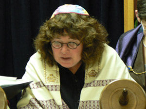 Woman reading from the Torah