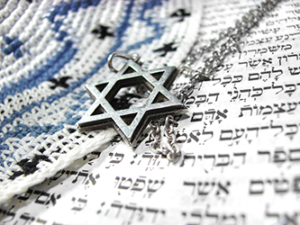 Jewish star, kippa and Hebrew text