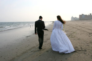 Jewish wedding on the beach with bride and groom