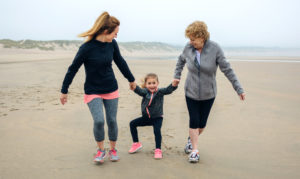 mother, daughter and grandmother on the beach
