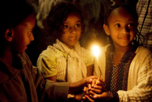 Ethiopian children lighting a candle in Jerusalem