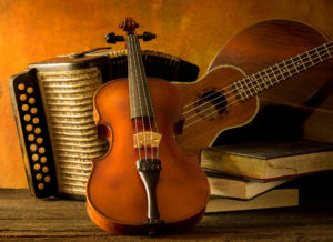 Violin, guitar, accordion, mandolin with music books