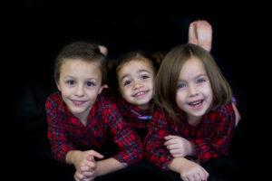 Three Happy Children in Pajamas